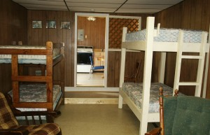 Cabin 1 offers 2 sets of bunk beds and a queen size bed.  Camper must bring their own linens.
