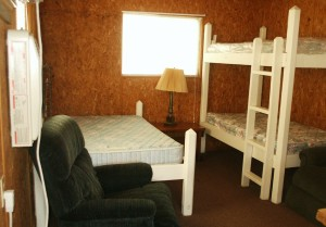 Cabin 2 has a full size bed  and a set of bunk beds.