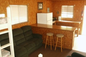 Plenty counter space and seating.  There is a range top and refrigerator as well.