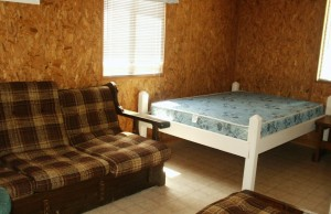 Cabin 3 has a full size bed and a set of bunk beds.