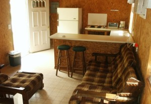 Cabin 3 features a breakfast bar for dining. There is plenty of counter space, a range top and a refrigerator.  Campers must bring all pots, pans and utensils.