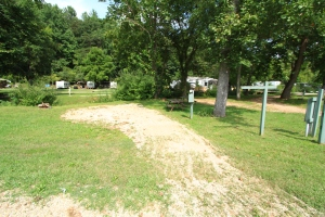A large, flat 30 Amp and water back in site located on the creek.  Shaded part of the day  with views of pool and grounds.